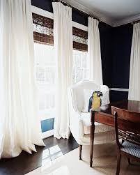 ashley putnam via lonny black walls white linen drapes woven wood