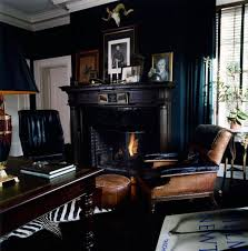 gorgeous eclectic navy blue living room with classic black leather