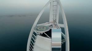 fly over burj al arab hotel in dubai uae burj al arab is a