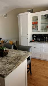 double door white corner pantry faced off two tones kitchen island