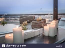 bath and candles in luxury hotel room stock photo royalty free