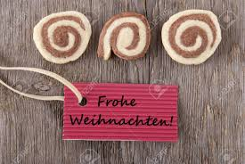 some cookies and a maker tag with the german words frohe weihachten