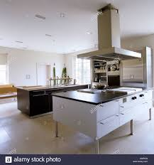 kitchen island extractor modern kitchen with island and large extractor fan stock photo