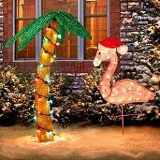 yard flamingos pulling santas sleigh because in florida reindeer