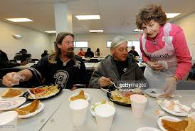 salvation army feeds homeless on thanksgiving day photos and