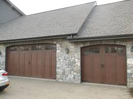 Miller Overhead Door by Clopay Canyon Ridge Collection Faux Wood Carriage House Garage
