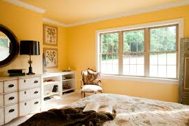 master bedroom with crown molding a bright yellow wall paint and