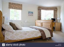 patterned brown cream blind and matching curtains on windows in