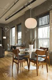 Modern Loft Furniture by Dining Room Table And Desk In A Modern Loft Setting Vertical