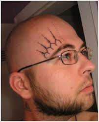 geometric style black ink ornaments on forehead tattoos