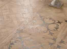 medium patterned wooden floor tiles with fleur de lis motif
