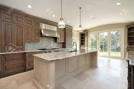 kitchen island construction kitchen in new construction home with large marble island stock