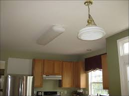 Led Kitchen Light Fixtures by Kitchen Adding Recessed Lighting Can Lights Replacing Recessed