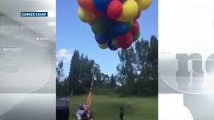 up in the air calgary man soars in lawn chair attached to helium