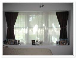 best way to hang curtains different ways to hang curtains a floral printed curtain hangs in a