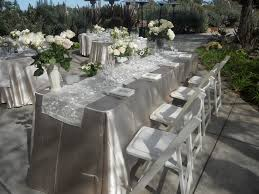 table runner rentals chagne satin linen with an ivory organza satin brocade table