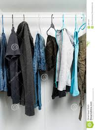 clothes hanging on rail in white wardrobe stock photo image