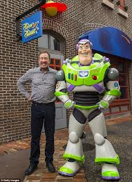 tim allen poses toy story alter ego buzz lightyear disney