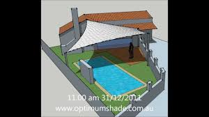 Wind Sail Patio Covers by Shade Sail Over Swimming Pool Wmv Youtube