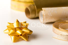 Present Decoration Golden Wrapping Paper And Bow Present Decoration Stock Photos