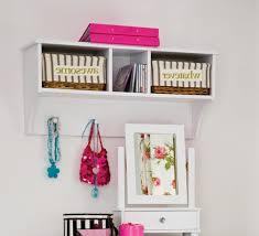 kids room white wooden books shelves on the white wall of