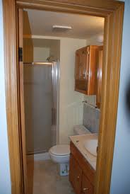 bathroom cabinets upflush toilet and shower basement shower pump