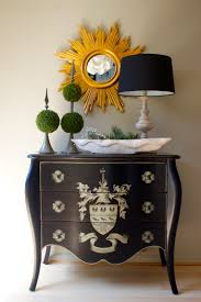 in vogue artwork wall mirror and black white shade table lamps