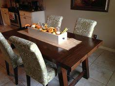 pottery barn farm dining table refinishing chairs to match that new cool dark pottery barn table