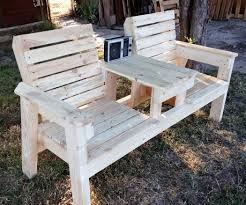 double chair bench with table with pictures