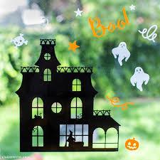 haunted house halloween window clings lia griffith