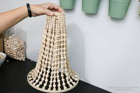 How To Make Homemade Chandelier Remodelaholic How To Make A Wood Bead Chandelier