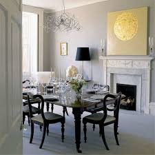 attractive dining room with chandelier dark wooden table firepalce