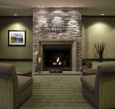 living room with stone fireplace with tv beige shag area rugs wall
