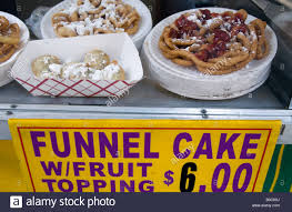 funnel cake for sale at a fair in new york city stock photo