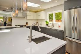 are white quartz countertops in style why your next countertop should be quartz european cabinets
