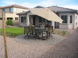exterior cream umbrella patio shade with dining table sets on