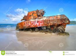 old tank at flamenco beach stock photo image 29228390