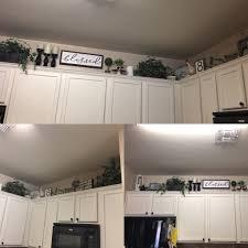 farmhouse kitchen cabinet decorating ideas pin by leticia on kitchen kitchen cabinets decor above