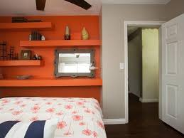 orange wall shelving unit with elegant comforter for girly bedroom