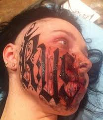 man tattoos his name across his girlfriend u0027s face and they only