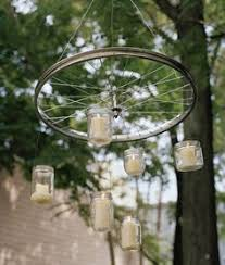 Mason Jar Wagon Wheel Chandelier A Chandelier Made Out Of A Bike Wheel Fishing Hooks And Mason