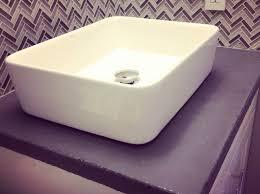 How To Put Up Backsplash Tile by How To Install Herringbone Backsplash Tile Snapguide