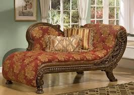 brown wooden lounge chair with carving ornaments combined with
