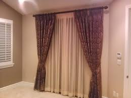 window drapes vertical blinds roman shades roller shades