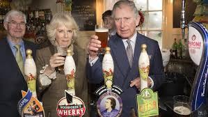 bottoms up charles and camilla pour pints at village pub nbc news