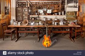 old style scene with dining room table and guitar stock photo