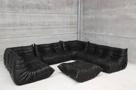 Large Black Leather Sofa Black Leather Sofa With Low Back Combined With Table On The Middle