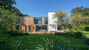 woodpeckers new forest uk strom architects side elevation