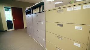 large filing cabinets cheap a man searches through large filing cabinets at his business stock