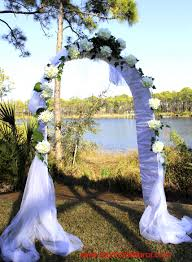 wedding arches using tulle wedding arch with white hydrangeas unique floral arrangements by
